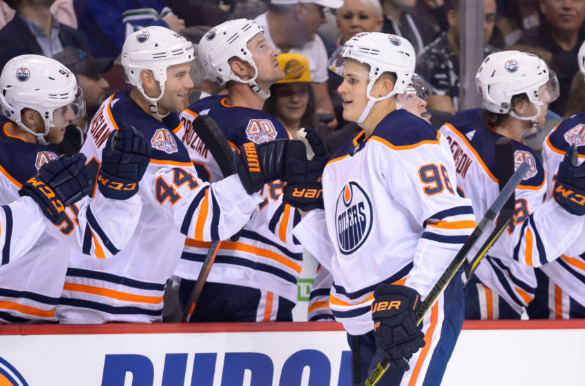 VANCOUVER, BC - SEPTEMBER 18: Edmonton Oilers right wing Jesse Puljujarvi (98) is congratulated at the players bench after scoring a goal during their NHL preseason game against the Vancouver Canucks at Rogers Arena on September 18, 2018 in Vancouver, British Columbia, Canada. (Photo by Derek Cain/Icon Sportswire via Getty Images)