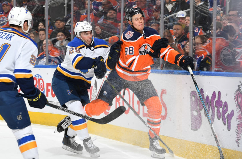 EDMONTON, AB - DECEMBER 18: Jesse Puljujarvi #98 of the Edmonton Oilers takes a hit from Vince Dunn #29 of the St. Louis Blues on December 18, 2018 at Rogers Place in Edmonton, Alberta, Canada. (Photo by Andy Devlin/NHLI via Getty Images)