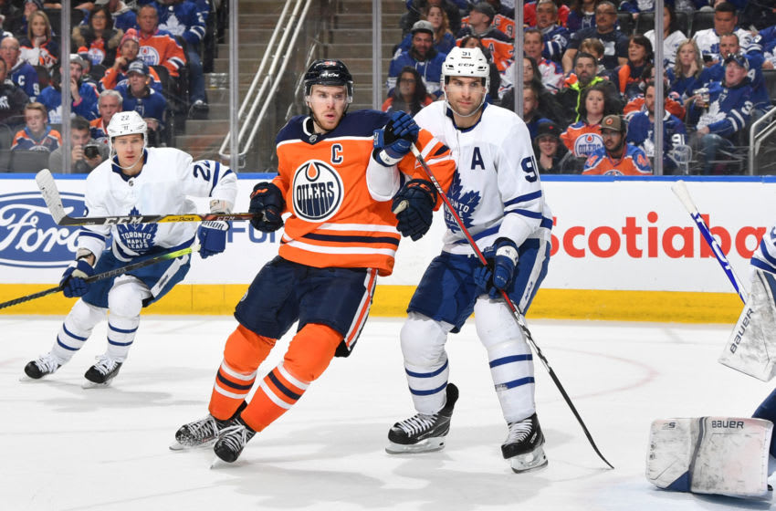 EDMONTON, AB - MARCH 9: Connor McDavid #97 of the Edmonton Oilers battles for position against John Tavares #91 of the Toronto Maple Leafs on March 9, 2019 at Rogers Place in Edmonton, Alberta, Canada. (Photo by Andy Devlin/NHLI via Getty Images)
