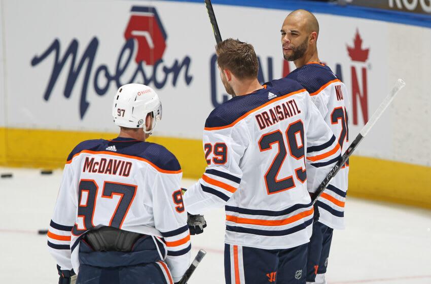Edmonton Oilers, Leon Draisaitl #29, Connor McDavid #97, Darnell Nurse #25 (Photo by Claus Andersen/Getty Images)