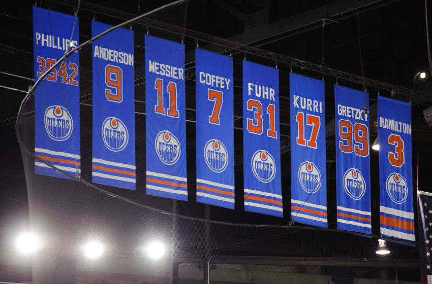 EDMONTON, CANADA - FEBRUARY 23: A view of the banners for radio broadcaster Rod Phillips and the retired numbers of previous Oilers players Glenn Anderson