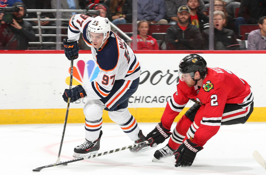 CHICAGO, IL - OCTOBER 19: Connor McDavid #97 of the Edmonton Oilers and Duncan Keith #2 of the Chicago Blackhawks battle for the puck in overtime at the United Center on October 19, 2017 in Chicago, Illinois. The Edmonton Oilers defeated the Chicago Blackhawks 2-1. (Photo by Chase Agnello-Dean/NHLI via Getty Images)
