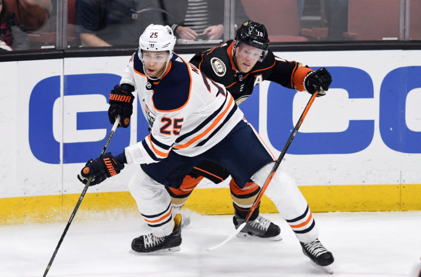 ANAHEIM, CA - FEBRUARY 09: Edmonton Oilers defenseman Darnell Nurse (25) keeps in front of Anaheim Ducks rightwing Corey Perry (10) during the first period of a game played on February 9, 2018 at the Honda Center in Anaheim, CA. (Photo by John Cordes/Icon Sportswire via Getty Images)