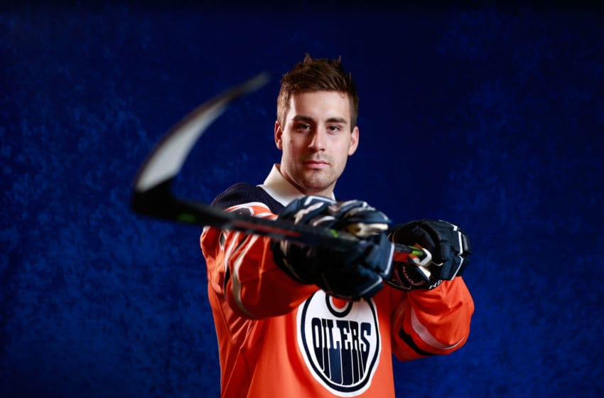 DALLAS, TX - JUNE 22: Evan Bouchard poses for a portrait after being selected tenth overall by the Edmonton Oilers during the first round of the 2018 NHL Draft at American Airlines Center on June 22, 2018 in Dallas, Texas. (Photo by Jeff Vinnick/NHLI via Getty Images)