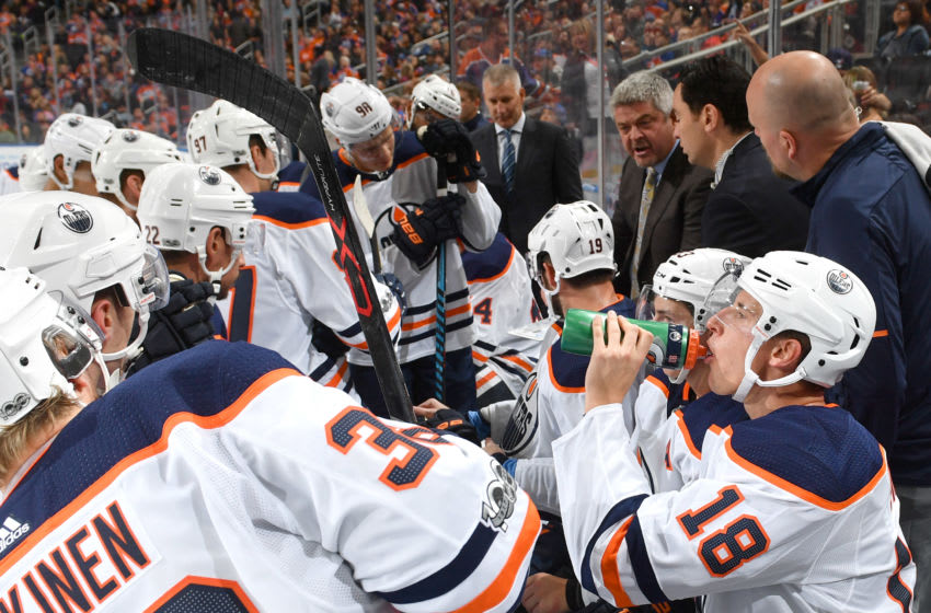 EDMONTON, AB - SEPTEMBER 23: Todd McLellan of the Edmonton Oilers discusses the play with the players during the preseason game against the Winnipeg Jets on September 23, 2017 at Rogers Place in Edmonton, Alberta, Canada. (Photo by Andy Devlin/NHLI via Getty Images)