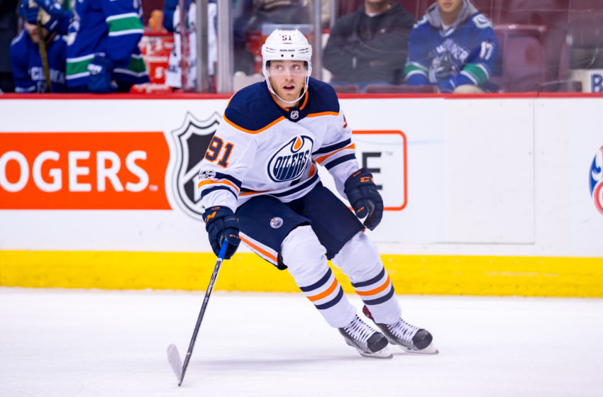 VANCOUVER, BC - SEPTEMBER 30: Edmonton Oilers center Drake Caggiula (91) looks up ice during their NHL preseason game against the Vancouver Canucks at Rogers Arena on September 30, 2017 in Vancouver, British Columbia, Canada. (Photo by Derek Cain/Icon Sportswire via Getty Images)