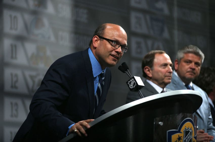 SUNRISE, FL - JUNE 26: Edmonton Oilers General Manager Peter Chiarelli addresses the audience as NHL Commissioner Gary Bettman and Oilers head coach Todd McClellan look on during Round One of the 2015 NHL Draft at BB