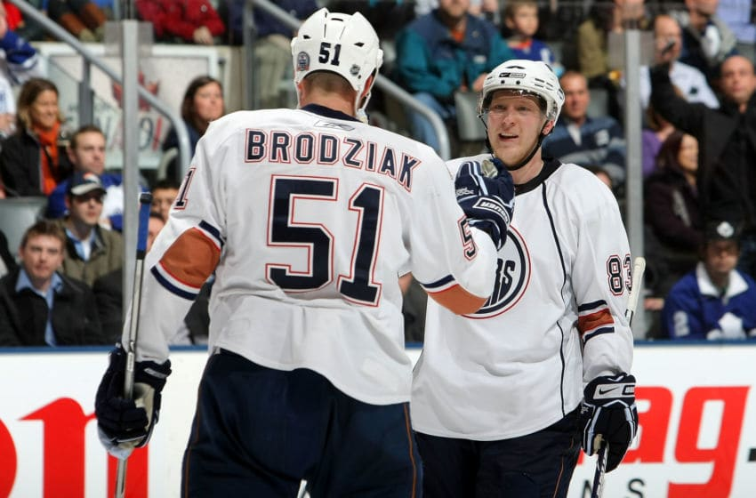 TORONTO - MARCH 7: Kyle Brodziak #51 of the Edmonton Oilers is congratulated by teammate Ales Hemsky #83 after scoring an empty net goal against the Toronto Maple Leafs during their NHL game at the Air Canada Centre March 7, 2009 in Toronto, Ontario, Canada. (Photo By Dave Sandford/Getty Images)