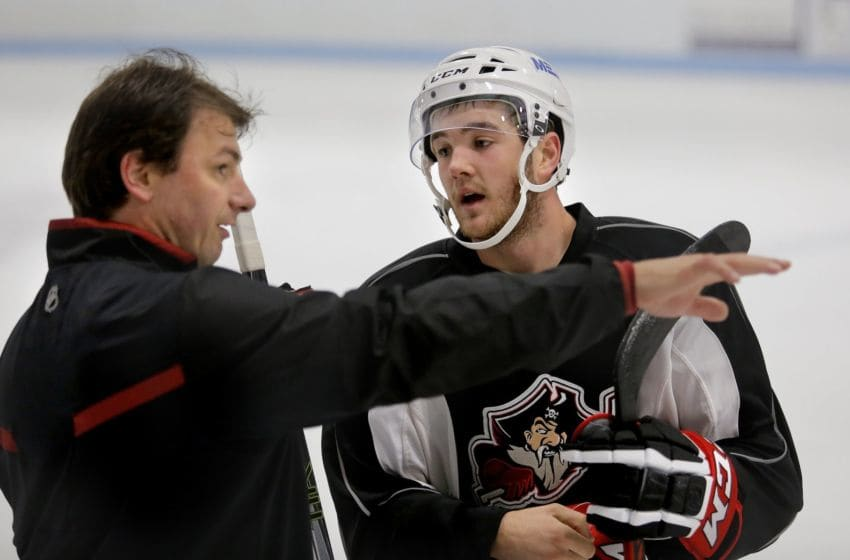 Josh Currie, at right, listens to Portland Pirates assistant coach John Slaney, at left, during the first day of training camp at the MHG Ice Arena in Saco, Monday morning, September 23, 2013. (Photo by Gabe Souza/Portland Press Herald via Getty Images)