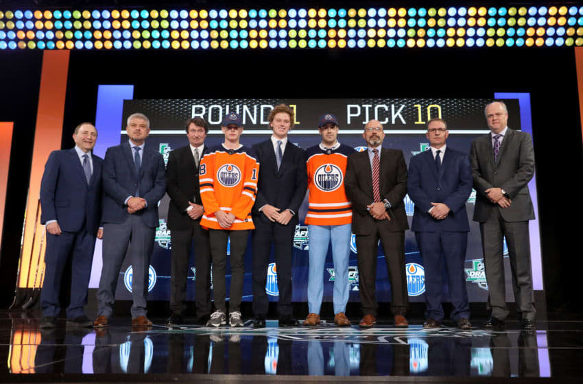 DALLAS, TX - JUNE 22: Evan Bouchard poses after being selected tenth overall by the Edmonton Oilers during the first round of the 2018 NHL Draft at American Airlines Center on June 22, 2018 in Dallas, Texas. (Photo by Bruce Bennett/Getty Images)