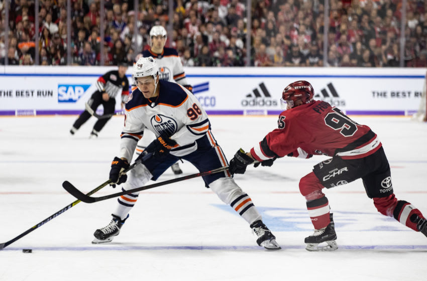 COLOGNE, GERMANY - OCTOBER 03: Jesse Puljujarvi of Edmonton is challenged by Fabio Pfohl of Koeln during the NHL Global Series Challenge game between Edmonton Oilers and Kolner Haie at Lanxess Arena on October 3, 2018 in Cologne, Germany. (Photo by Lars Baron/NHLI via Getty Images)