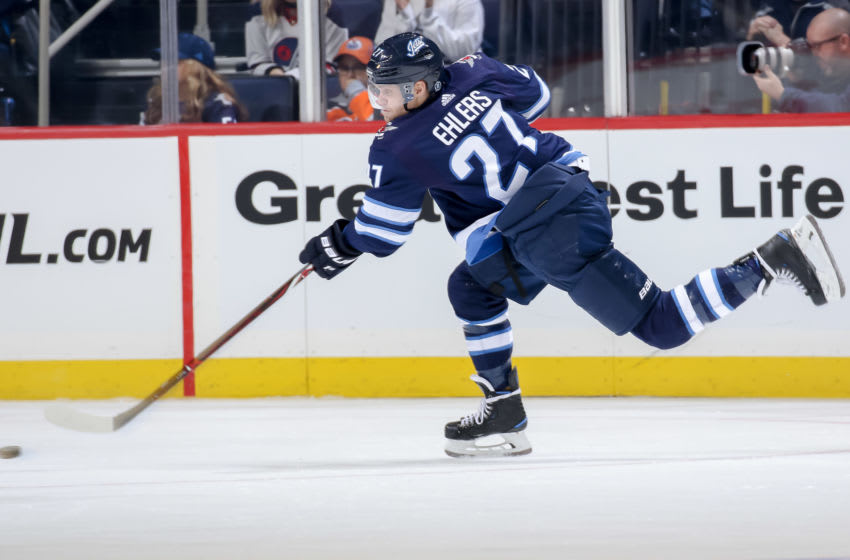WINNIPEG, MB - OCTOBER 16: Nikolaj Ehlers #27 of the Winnipeg Jets shoots the puck during third period action against the Edmonton Oilers at the Bell MTS Place on October 16, 2018 in Winnipeg, Manitoba, Canada. The Oilers defeated the Jets 5-4 in overtime. (Photo by Jonathan Kozub/NHLI via Getty Images)
