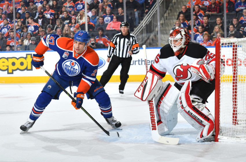 EDMONTON, AB - JANUARY 12: Milan Lucic #27 of the Edmonton Oilers takes position in front of Cory Schneider #35 of the New Jersey Devils on January 12, 2017 at Rogers Place in Edmonton, Alberta, Canada. (Photo by Andy Devlin/NHLI via Getty Images)