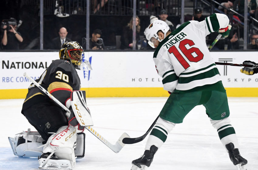 LAS VEGAS, NEVADA - MARCH 29: Malcolm Subban #30 of the Vegas Golden Knights blocks a shot as Jason Zucker #16 of the Minnesota Wild looks for a rebound in the first period of their game at T-Mobile Arena on March 29, 2019 in Las Vegas, Nevada. The Wild defeated the Golden Knights 3-2. (Photo by Ethan Miller/Getty Images)