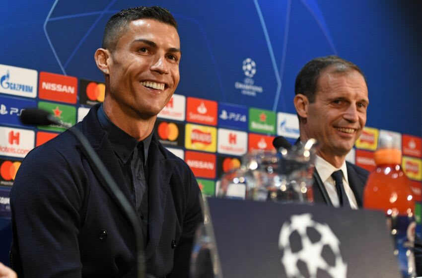 Juventus' Portuguese striker Cristiano Ronaldo (L) and Juventus' manager Massimiliano Allegri (R) attend a press conference at Old Trafford in Manchester, north west England on October 22, 2018, ahead of their UEFA Champions League group H football match against Juventus on October 23. (Photo by Oli SCARFF / AFP) (Photo credit should read OLI SCARFF/AFP via Getty Images)