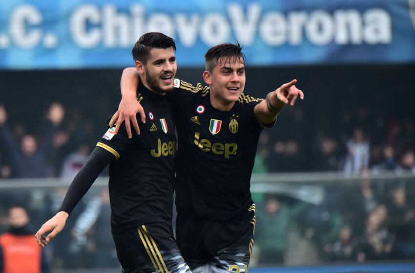 Juventus' forward from Spain Alvaro Morata (L) celebrates after scoring a goal with Juventus' forward from Argentina Paulo Dybala during the Serie A football match between Chievo Verona and Juventus on January 31, 2016 at Bentegodi Stadium in Verona. / AFP / GIUSEPPE CACACE (Photo credit should read GIUSEPPE CACACE/AFP via Getty Images)