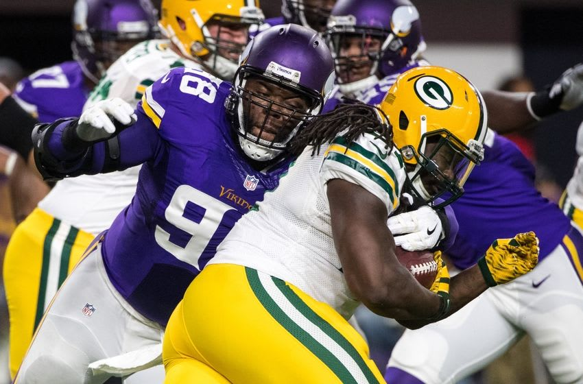 Sep 18, 2016; Minneapolis, MN, USA; Green Bay Packers running back Eddie Lacy (27) is tackled by Minnesota Vikings defensive tackle Linval Joseph (98) during the first quarter at U.S. Bank Stadium. Mandatory Credit: Brace Hemmelgarn-USA TODAY Sports