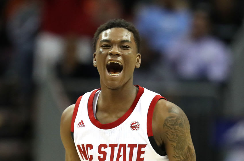 CHARLOTTE, NORTH CAROLINA - MARCH 13: Markell Johnson #11 of the NC State Wolfpack reacts after a play against the Clemson Tigers during their game in the second round of the 2019 Men's ACC Basketball Tournament at Spectrum Center on March 13, 2019 in Charlotte, North Carolina. (Photo by Streeter Lecka/Getty Images)