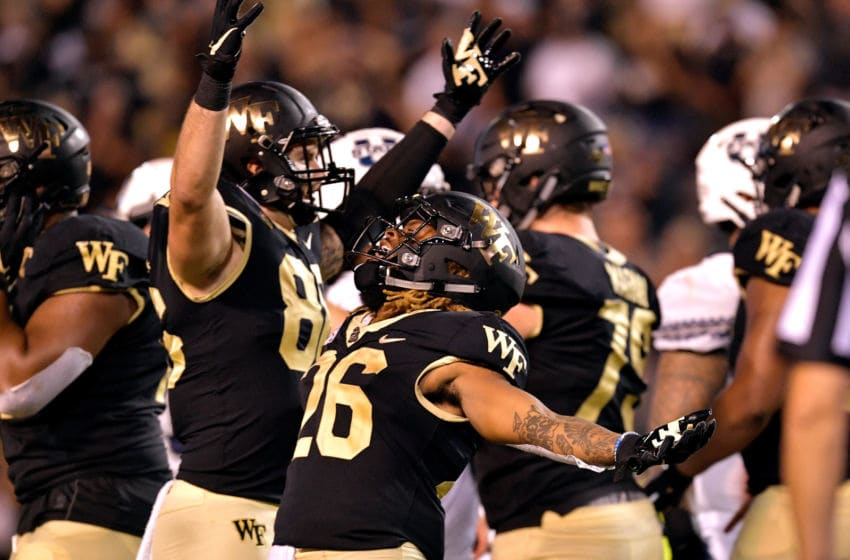 WINSTON SALEM, NORTH CAROLINA - AUGUST 30: Wake Forest Demon Deacons players celebrate after a win over the Utah State Aggies after their game at BB&T Field on August 30, 2019 in Winston Salem, North Carolina. Wake Forest won 38-35. (Photo by Grant Halverson/Getty Images)