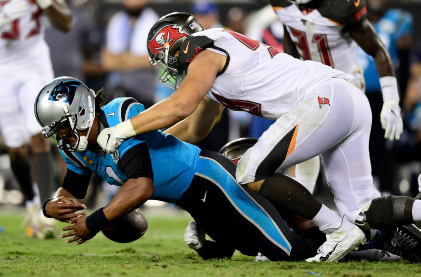 CHARLOTTE, NORTH CAROLINA - SEPTEMBER 12: Cam Newton #1 of the Carolina Panthers fumbles the ball in the third quarter during their game against the Tampa Bay Buccaneers at Bank of America Stadium on September 12, 2019 in Charlotte, North Carolina. (Photo by Jacob Kupferman/Getty Images)