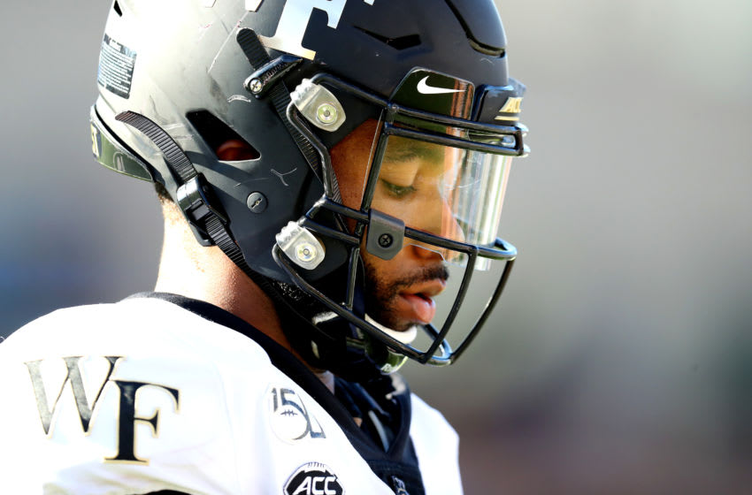 CHESTNUT HILL, MASSACHUSETTS - SEPTEMBER 28: Jamie Newman #12 of the Wake Forest Demon Deacons looks on during the first half of the game between the Boston College Eagles and the Wake Forest Demon Deacons at Alumni Stadium on September 28, 2019 in Chestnut Hill, Massachusetts. (Photo by Maddie Meyer/Getty Images)