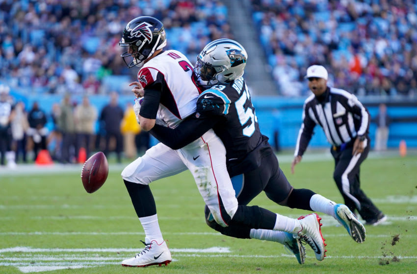 CHARLOTTE, NORTH CAROLINA - NOVEMBER 17: Brian Burns #53 of the Carolina Panthers forces a fumble by Matt Ryan #2 of the Atlanta Falcons during a two-point conversion attempt during the third quarter during their game at Bank of America Stadium on November 17, 2019 in Charlotte, North Carolina. (Photo by Jacob Kupferman/Getty Images)
