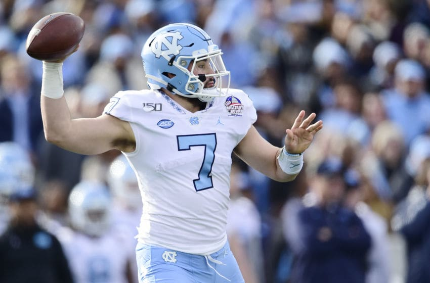 ANNAPOLIS, MD - DECEMBER 27: Quarterback Sam Howell #7 of the North Carolina Tar Heels throws a pass in the first half against the Temple Owls in the Military Bowl Presented by Northrop Grumman at Navy-Marine Corps Memorial Stadium on December 27, 2019 in Annapolis, Maryland. (Photo by Patrick McDermott/Getty Images)