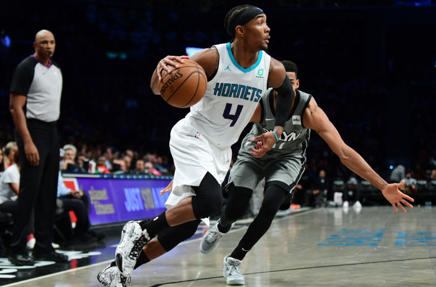 NEW YORK, NEW YORK - DECEMBER 11: Devonte' Graham #4 of the Charlotte Hornets drives past Garrett Temple #17 of the Brooklyn Nets during the second half at Barclays Center on December 11, 2019 in New York City. NOTE TO USER: User expressly acknowledges and agrees that, by downloading and or using this photograph, User is consenting to the terms and conditions of the Getty Images License Agreement. (Photo by Emilee Chinn/Getty Images)