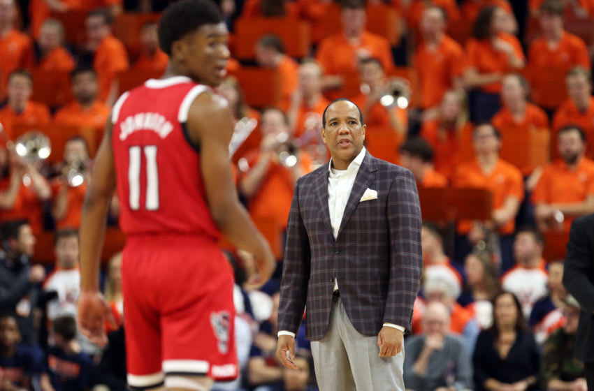 CHARLOTTESVILLE, VA - JANUARY 20: Head coach Kevin Keatts of the North Carolina State Wolfpack calls a time out beside Markell Johnson #11 in the first half during a game against the Virginia Cavaliers at John Paul Jones Arena on January 20, 2020 in Charlottesville, Virginia. (Photo by Ryan M. Kelly/Getty Images)