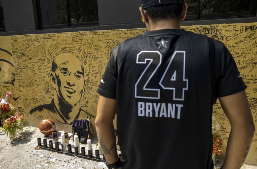 VALENZUELA, PHILIPPINES - JANUARY 28: A basketball fan looks on at a mural of former NBA star Kobe Bryant outside the