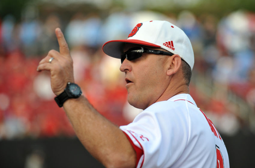 RALEIGH, NC - APRIL 26: Head Coach Elliott Avent of the North Carolina State Wolfpack points up prior to a game against the North Carolina Tar Heels at Doak Field on April 26, 2013 in Raleigh, North Carolina. North Carolina defeated NC State 7-1. (Photo by Lance King/Getty Images)