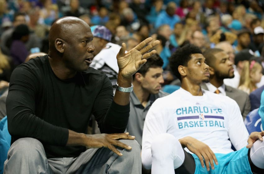 CHARLOTTE, NC - NOVEMBER 01: Michael Jordan, owner of the Charlotte Hornets sits on the bench with Jeremy Lamb #3 of the Charlotte Hornets during their game at Time Warner Cable Arena on November 1, 2015 in Charlotte, North Carolina. NOTE TO USER: User expressly acknowledges and agrees that, by downloading and or using this photograph, User is consenting to the terms and conditions of the Getty Images License Agreement. (Photo by Streeter Lecka/Getty Images)