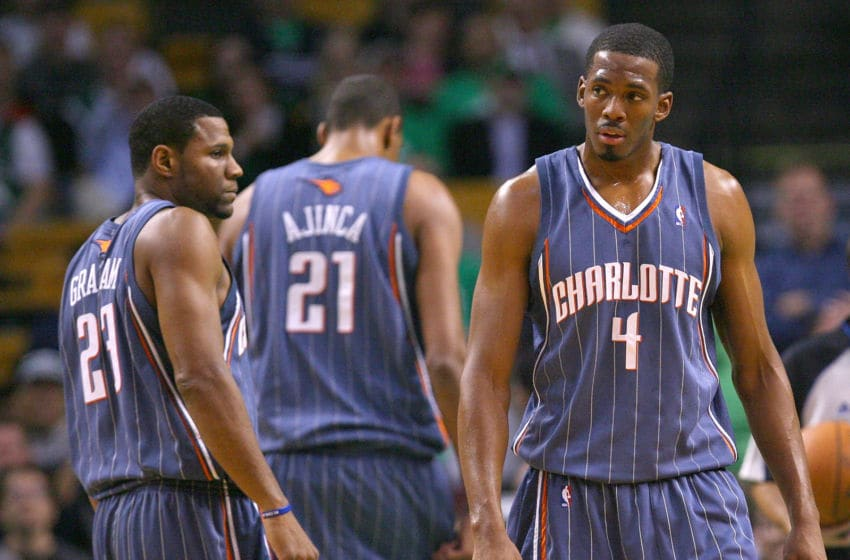 BOSTON, MA - OCTOBER 28: Stephen Graham #23, Alexis Ajinca #21 and Derrick Brown #4 of the Charlotte Bobcats react during a game with the Boston Celtics at the TD Banknorth Garden on October 28, 2009 in Boston, Massachusetts. NOTE TO USER: User expressly acknowledges and agrees that, by downloading and/or using this Photograph, user is consenting to the terms and conditions of the Getty Images License Agreement. (Photo by Jim Rogash/Getty Images)