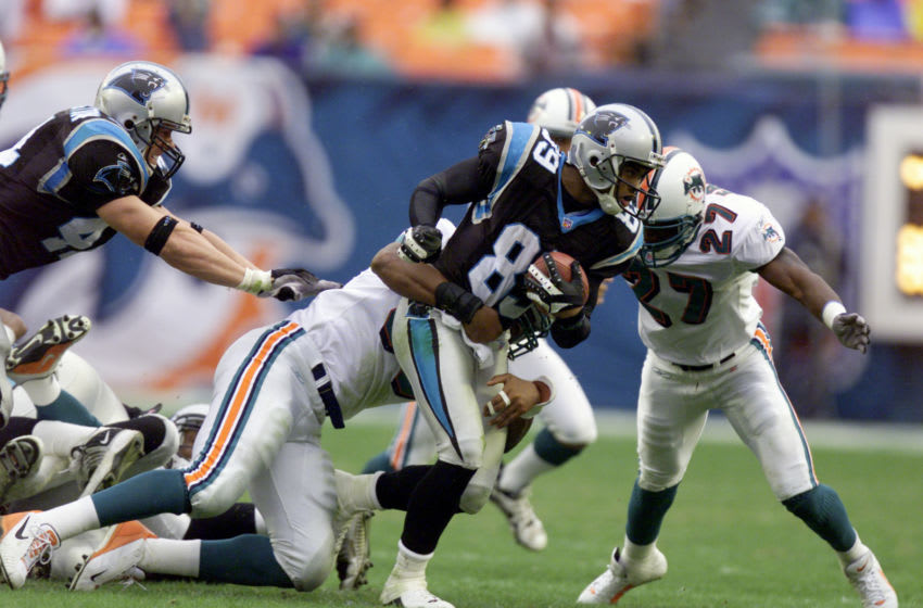 4 Nov 2001 : Steve Smith #89 of the Carolina Panthers is stopped by the Miami Dolphins defense during the game at Pro Player Stadium in Miami, Florida. DIGITAL IMAGE. Mandatory Credit: Eliot Schechter/Allsport