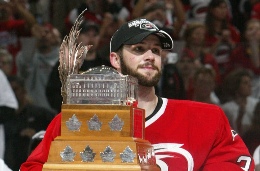 RALEIGH, NC - JUNE 19: Goaltender Cam Ward #30 of the Carolina Hurricanes poses with the Conn Smythe trophy after defeating the Edmonton Oilers in game seven of the 2006 NHL Stanley Cup Finals on June 19, 2006 at the RBC Center in Raleigh, North Carolina. The Hurricanes defeated the Oilers 3-1 to win the Stanley Cup finals 4 games to 3. (Photo by Dave Sandford/Getty Images)