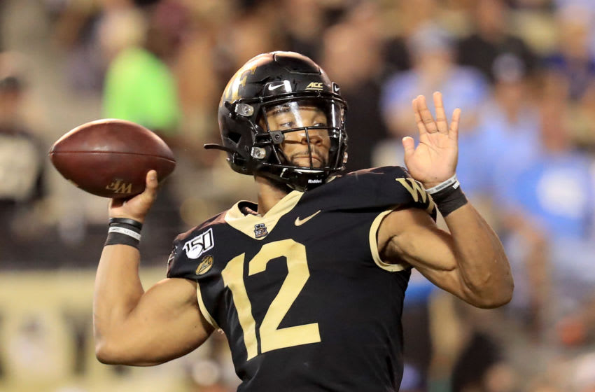 WINSTON SALEM, NORTH CAROLINA - SEPTEMBER 13: Jamie Newman #12 of the Wake Forest Demon Deacons drops back to pass against the North Carolina Tar Heels during their game at BB&T Field on September 13, 2019 in Winston Salem, North Carolina. (Photo by Streeter Lecka/Getty Images)