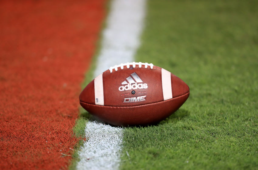 RALEIGH, NORTH CAROLINA - OCTOBER 10: A detailed view of a football before the game between the Syracuse Orange and North Carolina State Wolfpack at Carter Finley Stadium on October 10, 2019 in Raleigh, North Carolina. (Photo by Streeter Lecka/Getty Images)
