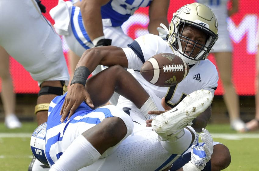 DURHAM, NORTH CAROLINA - OCTOBER 12: Victor Dimukeje #51 of the Duke Blue Devils forced a fumble by James Graham #4 of the Georgia Tech Yellow Jackets during the first half of their game at Wallace Wade Stadium on October 12, 2019 in Durham, North Carolina. (Photo by Grant Halverson/Getty Images)