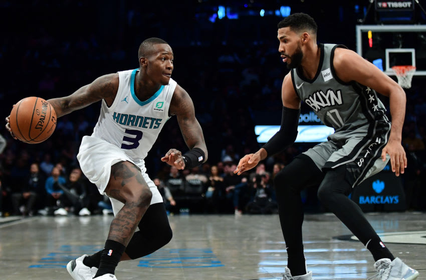 NEW YORK, NEW YORK - DECEMBER 11: Terry Rozier #3 of the Charlotte Hornets drives past Garrett Temple #17 of the Brooklyn Nets during the second half at Barclays Center on December 11, 2019 in New York City. NOTE TO USER: User expressly acknowledges and agrees that, by downloading and or using this photograph, User is consenting to the terms and conditions of the Getty Images License Agreement. (Photo by Emilee Chinn/Getty Images)