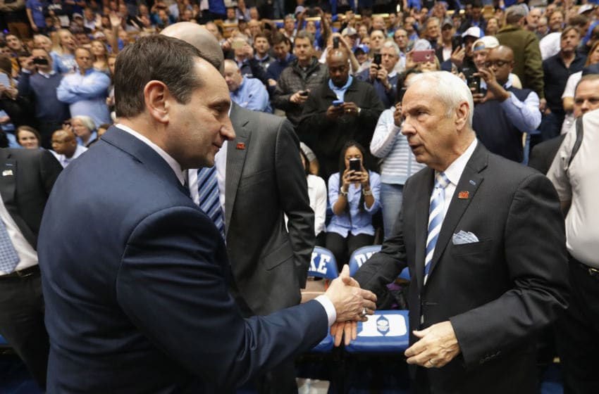 DURHAM, NC - FEBRUARY 09: (L-R) Head coach Mike Krzyzewski of the Duke Blue Devils and head coach Roy Williams of the North Carolina Tar Heels shake hands prior to their gaem at Cameron Indoor Stadium on February 9, 2017 in Durham, North Carolina. (Photo by Streeter Lecka/Getty Images)