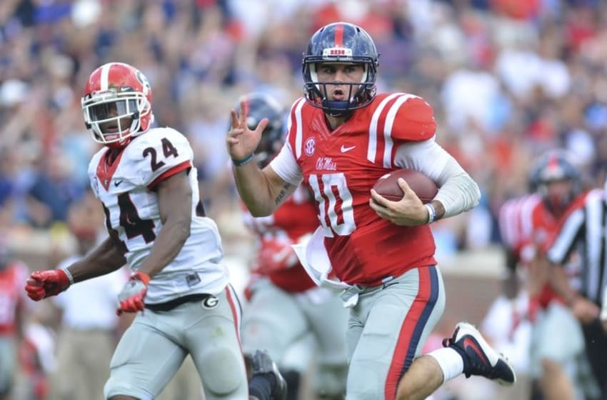 Sep 24, 2016; Oxford, MS, USA; Mississippi Rebels quarterback Chad Kelly (10) runs the ball during a play that would result in a touchdown during the third quarter of the game against the Georgia Bulldogs at Vaught-Hemingway Stadium. Mississippi won 45-14. Mandatory Credit: Matt Bush-USA TODAY Sports