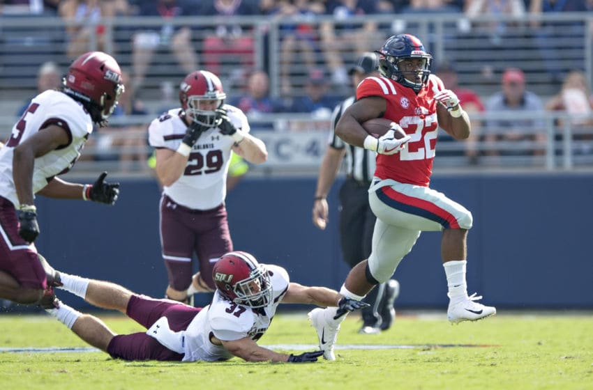 OXFORD, MS - SEPTEMBER 8: Scottie Phillips #22 of the Mississippi Rebels out runs the grasp of Michael Elbert #37 of the Southern Illinois Salukis during the first half at Vaught-Hemingway Stadium on September 8, 2018 in Oxford, Mississippi. (Photo by Wesley Hitt/Getty Images)