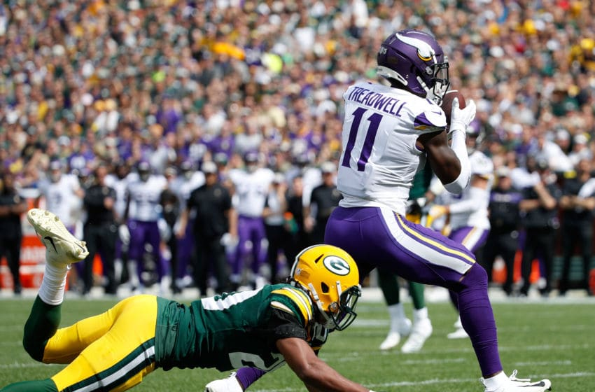 GREEN BAY, WI - SEPTEMBER 16: Laquon Treadwell #11 of the Minnesota Vikings catches a touchdown pass in front of Kevin King #20 of the Green Bay Packers during the first quarter of a game at Lambeau Field on September 16, 2018 in Green Bay, Wisconsin. (Photo by Joe Robbins/Getty Images)