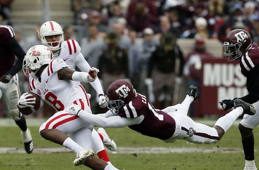 COLLEGE STATION, TEXAS - NOVEMBER 10: Elijah Moore #8 of the Mississippi Rebels is tackled from behind by Keldrick Carper #14 of the Texas A&M Aggies in the fourth quarter at Kyle Field on November 10, 2018 in College Station, Texas. (Photo by Bob Levey/Getty Images)