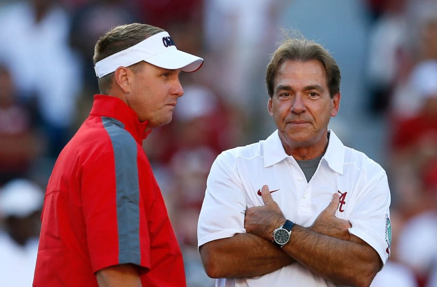 TUSCALOOSA, AL - SEPTEMBER 28: Head coach Hugh Freeze of the Mississippi Rebels converses with head coach Nick Saban of the Alabama Crimson Tide prior to their game at Bryant-Denny Stadium on September 28, 2013 in Tuscaloosa, Alabama. (Photo by Kevin C. Cox/Getty Images)