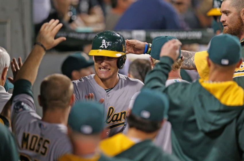 CHICAGO, IL - SEPTEMBER 09: Nate Freiman #35 of the Oakland Athletics is greeted by teammates in the dugout after scoring a run in the 9th inning against the Chicago White Sox at U.S. Cellular Field on September 9, 2014 in Chicago, Illinois. The Athletics defeated the White Sox 11-2. (Photo by Jonathan Daniel/Getty Images)