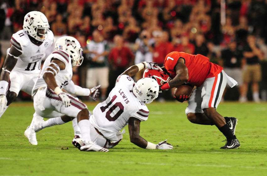 ATHENS, GA - SEPTEMBER 23: D'Andre Swift #7 of the Georgia Bulldogs is tackled by Leo Lewis #10 of the Mississippi State Bulldogs at Sanford Stadium on September 23, 2017 in Athens, Georgia. (Photo by Scott Cunningham/Getty Images)
