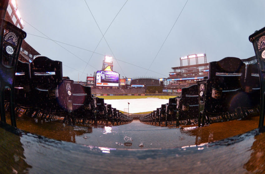 DENVER, CO - MAY 28: Rain and hail cause a weather delay before the start of a game between the Colorado Rockies and the San Francisco Giants at Coors Field on May 28, 2018 in Denver, Colorado. (Photo by Dustin Bradford/Getty Images)