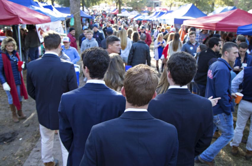 OXFORD, MS - OCTOBER 28: Fans of the Ole Miss Rebels walk through the Grove before a game against the Arkansas Razorbacks at Hemingway Stadium on October 28, 2017 in Oxford, Mississippi. (Photo by Wesley Hitt/Getty Images)