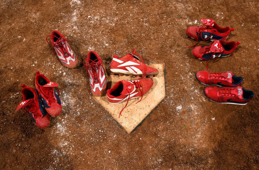 BEIJING - AUGUST 21: The shoes worn by players from the United States remain at home plate after the five players left them there following USA's 3-1 loss to Japan during the women's grand final gold medal softball game at the Fengtai Softball Field during Day 13 of the Beijing 2008 Olympic Games on August 21, 2008 in Beijing, China. (Photo by Jonathan Ferrey/Getty Images)